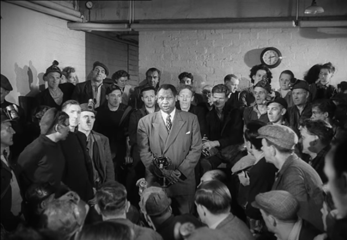 In this photo from a 1949 National Coal Board film, Robeson sings the labor ballad I Dreamed I Saw Joe Hill to the Scottish miners